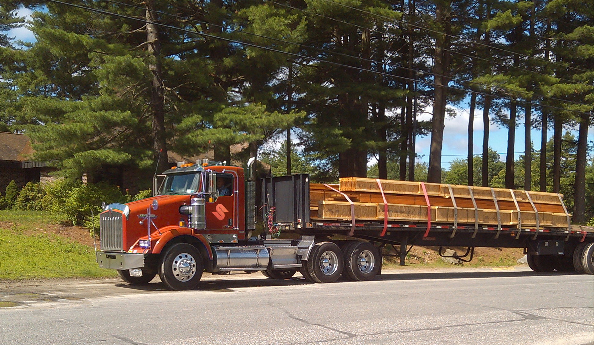 Stuck lumber truck dumping load - YouTube